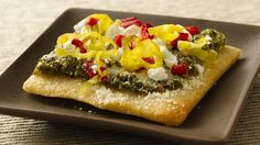 Tapenade Flatbread Appetizers Refrigerated pizza crust makes quick work of home-baked appetizers topped with delicious Mediterranean ingredients.