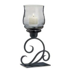 "by Gallery of Light A flourish of style makes this candle holder a real standout. The black iron base features a scrolling flourish design on a flat rectangular base. Above is a smoked glass candle cup that will shimmer when you light a candle inside. 7.25"" x 4.25"" x 13.5""  www.allgooddecor.com/shop.html #allgooddecor #decorations #gifts #candles #toys #discount #furniture #candleholders #home #figurines #lighting #pictures #mirrors #jewelry #garden #clearance #kitchen #bedandbath #wallart"
