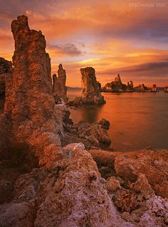 A fiery sunset covers the sky above Mono Lake, California