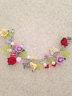 #Butterfly #Flower #Garden #Charm #Bracelet by #RaindropsOnRosesBtq  #Etsy #jewelry #jewellry #butterflyjewelry #flowerjewelry #charmbracelet #nofilter #gift #lovely #woman #women #polymerclay #fashion