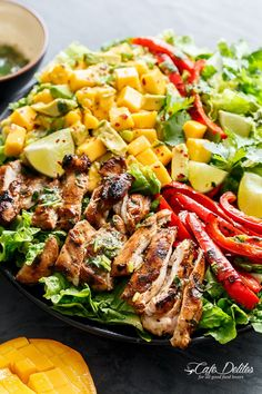 Cilantro Lime Chicken Salad With A Mango And Avocado Salsa! Holding onto Summer for a just a bit longer, this Cilantro Lime Chicken Salad has so much flavour in it with a creamy/sweet Mango Avocado Salsa for an extra Summer feel!
