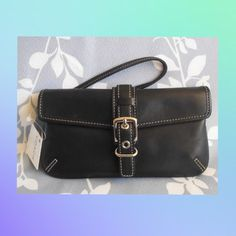 """Coach Hamptons Skinny Wristlet Authentic.  Style no. 4751.  Black leather with polished nickel hardware.  Measures about 7.25"""" w x 4"""" h.  It has a strap with a lobster claw clasp, beige interior lining and leather Coach hang tag.  No trades or PayPal. Coach Bags Clutches & Wristlets"""