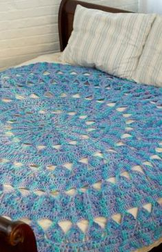 Medallion Circular Throw Crochet Pattern - Whether used on a bed or wrapped around you on the sofa, this throw is the perfect addition to your surroundings. It's made in easy-care yarn so you can use it all the time and just machine wash and dry.