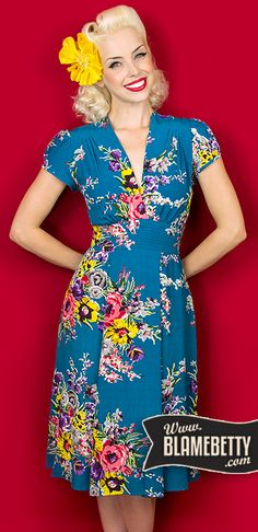 The stunning Ashley Dress in Turquoise Floral will have you looking absolutely ravishing with the classic elegance of the 1950's. #blamebetty #pinupfashion #retro