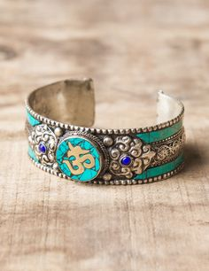 Turquoise Om Cuff http://www.sivanaspirit.com/collections/women-jewelry/products/turquoise-om-cuff#