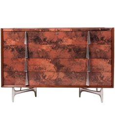 Chest of Drawers by Donald Deskey | From a unique collection of antique and modern commodes and chests of drawers at https://www.1stdibs.com/furniture/storage-case-pieces/commodes-chests-of-drawers/