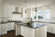 How do you get white kitchen cabinets without tearing up your kitchen and emptying out your bank account? Here are some helpful tips.