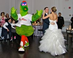Philly Phanatic wants his turn with the bride.