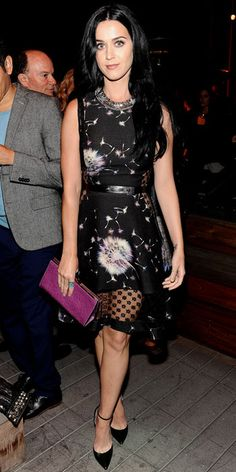 04/11/13: Katy Perry looked great for a good cause in a peek-a-boo Thakoon cocktail dress, jeweled Dannijo necklace, purple clutch and ankle-strap heels at Coach's Evening of Cocktails and Shopping. #lookoftheday