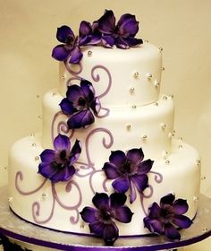 Purple flower wedding cake. Minus purple flowers plus black eyed susans or small sunflowera