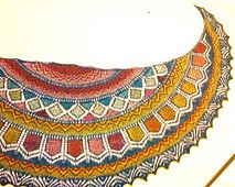 A small crescent shawl with a handcrafted ethnic look. Inspired by flowers, it can be worked in a muted palette or a riot of colors!