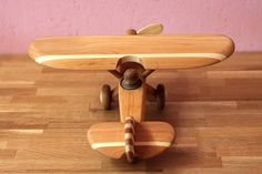The Wooden Airplane from different types of wood, covered with special oil on wood. Suitable for children and adults. It has moving parts (screw) If you have questions, please contact :) Dimensions: long-300mm, wide-300mm, tall-115mm or 11,8 long; 11,8 wide; 4,5 tall