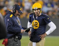 Green Bay Packers quarterback Aaron Rodgers talks with coach Miker McCarthy during the fourth quarter of Sunday's game against the Cleveland Browns at Lambeau Field.