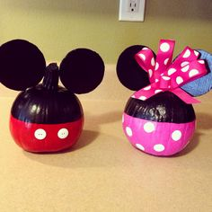 My painted Mickey and Minnie Mouse pumpkins! The trick to making these come out right is to first use 2 coats of a sealant (I used spray polyurethane) before you begin painting. It makes the pumpkin last longer, as well as makes it easier to paint. I used a cardboard box cutout for the ears, and E6000 glue to hold them in place. My kids LOVE them! :) #paintedpumpkins #mickeypumpkin #minniepumpkin