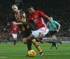 Marcus Rashford of Manchester United in action with David Meyler of Hull City during the EFL Cup Semi-FInal first leg match between Manchester United and Hull City at Old Trafford on January 10, 2017 in Manchester, England.