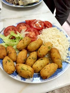 Eat Local with Bolinhos de Bacalhau at a Traditional Working Class Restaurant in Lisbon