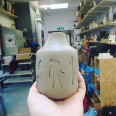 Wee pot, not fired, sans glaze