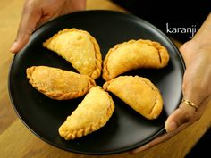 karanji recipe, karjikai recipe, kajjikayalu, kayi kadubu recipe with step by step photo/video recipe. a deep fried dumplings stuffed with coconut & sugar