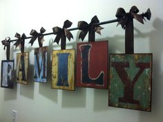Hallway decor ~ Metal letters from Hobby lobby, wired ribbon and a curtain rod.