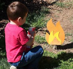 """Firefighter Birthday Party Activity: Spray water from spray bottle """"fire extinguishers"""" at foam paper """"fire"""" staked around the yard. The preschoolers LOVED this game!"""