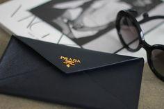 prada. envelope wallet. gold hardware.