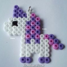 Unicorn pendant Made with beads (Hama) For necklace or to put on a keychain size approx x cm Another model or color on request/order Easy Perler Bead Patterns, Melty Bead Patterns, Diy Perler Beads, Perler Bead Art, Pearler Beads, Fuse Beads, Beading Patterns, Art Perle, Pixel Beads