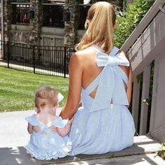 * Mommy: Bow in the back<br /> * Material: 100% Cotton<br /> * Machine wash, tumble dry<br /> * Imported