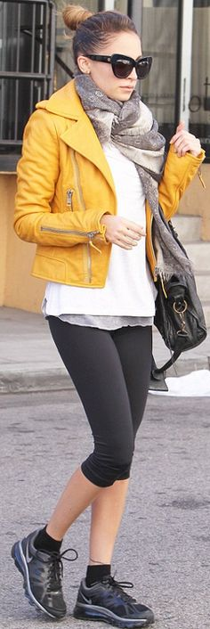 Who made  Nicole Richie's black capri pants, yellow leather jacket, black sunglasses, and black handbag that she wore in Los Angeles?