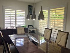 Wide louvers and bright whites are stunning in this dining room. #plantationshutters #modern #reallife