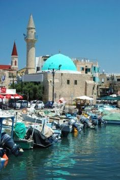 Old Akko harbor in NW Israel - the place to see ruins, drink pomegranate juice and sit by the harbour