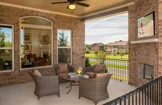 Outdoor Living Area With Fireplace And Patio Furniture; The Celestial Floor  Plan, Drees Homes