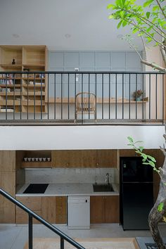 IZ architects completes vietnamese house with front courtyard enclosed by steel grid Front Courtyard, Courtyard House, Facade House, Indoor Courtyard, Courtyard Design, Narrow House Designs, Balcony Railing Design, House On Stilts, Container House Design
