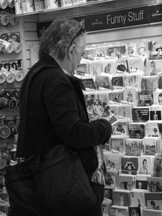 September 25, 2010 -- Alan Rickman shopping for a card. The card in his hand has Mickey Mouse on it. :-)