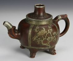 Chinese Yixing Teapot, China, 20th c., Yixing tea pot with metal work of birds perched in trees.