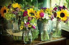 Sunflowers, wax flowers, billy bobs, daisies, etc. ||  fia AFloral