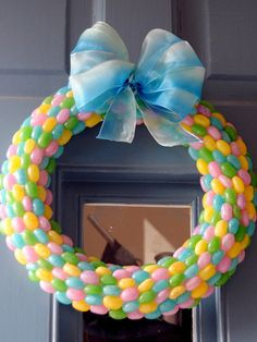 All you need to DIY this sweet front-door decoration is a wreath form, two bags of jelly beans, and a hot glue gun.