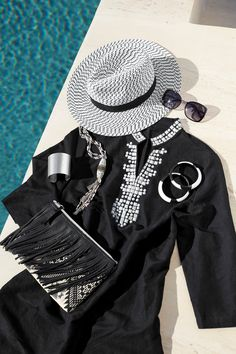 Black and white accents are perfect for those staying chic by the pool.