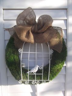 Large Moss Wreath with Bird in Birdcage and Burlap Bow.... Excellent bow for Christmas wreath minus the birdcage for the outside windows
