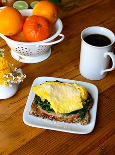 Popeye would be pleased with this open-faced egg sandwich! It has 3 full cups of fresh spinach atop toast with Canadian bacon and scrambled eggs. It's a hearty, nutritious meal to start your day right. #breakfast #eggsandwich #canadianbacon #spinach #eggwhites