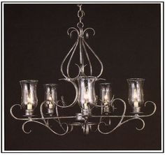 """6080  FIVE LIGHT IRON CHANDELIER FINISH SHOWN: PEWTER SHADE: SHOWN WITH HURRICANE GLASS, AVAILABLE WITH 3X7X4 SHADE WITH WHITE WAX CANDLES MAXIMUM WATTAGE: 300 CANDELABRA BASE SOCKETS  HT 24"""" W 30"""""""