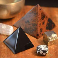 Mahogany Obsidian Pyramids bring grounding and stabilizing energies to provide protection to your space. #pyramids