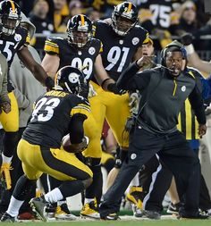Steelers' Jason Worilds intercepts a ball against the Ravens in front of defensive assistant Joey Porter in the second quarter at Heinz Field Sunday night - Pittsburgh Post-Gazette