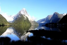 """Dawn reflections of Mitre Peak (1692m) in Milford Sound, South Island, New Zealand  <a href=""""http://www.robertdowniephotography.com"""">www.robertdowniephotography.com</a> Love Life, Love Photography"""