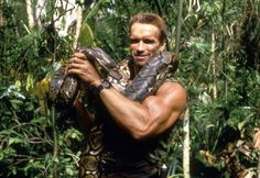 1987 Arnold Schwarzenegger posing with snake behind the scenes for Predator 80s Movies, Action Movies, Great Movies, Comic Movies, Movie Characters, Predator Movie, Alien Vs Predator, Predator Arnold, Arnold Movies