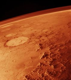 "Atmosphere of Mars taken from low orbit. The Galle ""smiley"" crater can be seen to the left. Viking Orbiter, 1976"