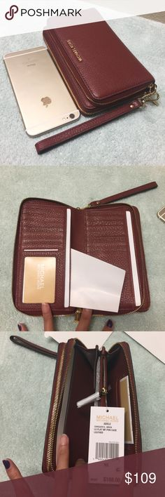 New Michael Kors double zippers leather wristlet Brand new. Never used. Never worn. In a perfect condition. 100% cow leather. With many many layers. And 16 card slots. Double zippers make it super organized . Size is 7x5 x 2. Will fit an iPhone 6 plus easily. The wristlet is detachable The color is brick on the tag. Tag price is $168. The price is firm. Please don't waste your time bargaining. Michael Kors Bags Clutches & Wristlets