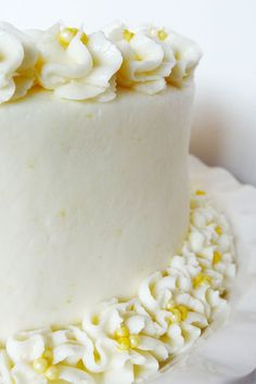 Triple Lemon Cake - Lemon Buttercream -  1 1/2 cups butter;  1 1/2 cups shortening;  12 cups (3 lbs) powdered sugar;  3 tsp finely grated lemon zest;  6 tbsp lemon juice;  3/4 tsp vanilla;  1-2 tsp water - plus more to the consistency you want.  Mix butter, shortening. Add 6 c powdered sugar. Add lemon juice/zest, vanilla. Add 1/2 t water plus until right. . . . Assemble - Cut cake in half. Fill 2 layers with buttercream, 2 with curd. Frost outside.