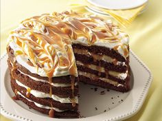 Luscious layers of chocolate cake, whipped cream, caramel topping and nuts will tempt you. Yum!