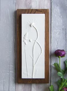 Daisy plaster cast tile on stained Ash