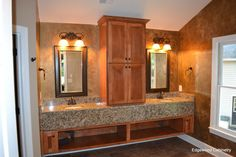 A modern maple vanity with granite top and skirt.